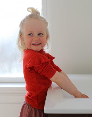 Topp i merinoull med krusvolanger för barn